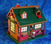 It's a little log cabin, complete with green roof, two gabled windows on top and a front porch. And behind 24 windows and openings are birds of all kinds, to be brought out and perched, one by one, during the countdown to Christmas.